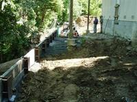 Wood bulkhead retaining wall with steel I-Beams using Tieback anchors.